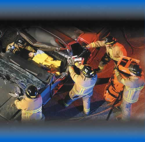 Accident Scene showing firemen attending to a car crash